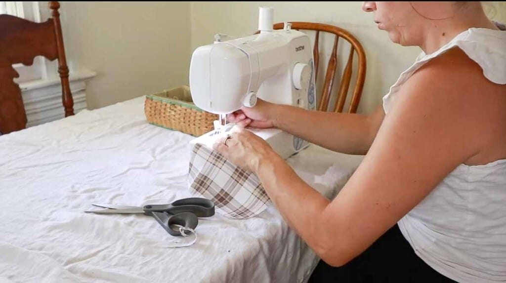 women sitting at a sewing machine sewing a pocket